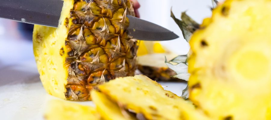 Cutting a pineapple.